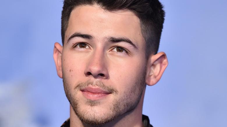 Nick Jonas smirking