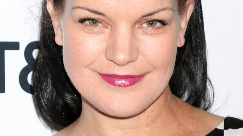Pauley Perrette smiling for cameras