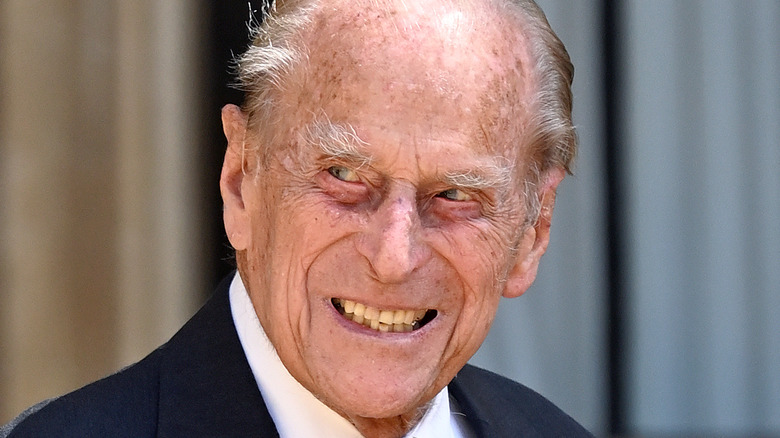 Prince Philip smiling outside, close-up