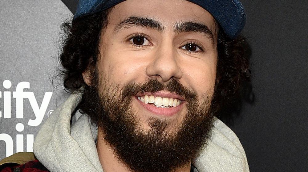 Ramy Youssef smiling in cap