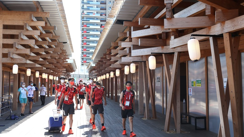 Athletes wearing red in Tokyo Olympic Village