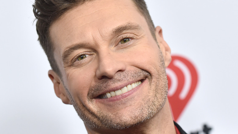 Ryan Seacrest smiles on a Capital One Red Carpet