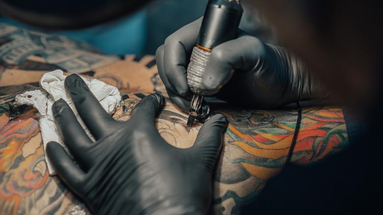 Person getting tattoo
