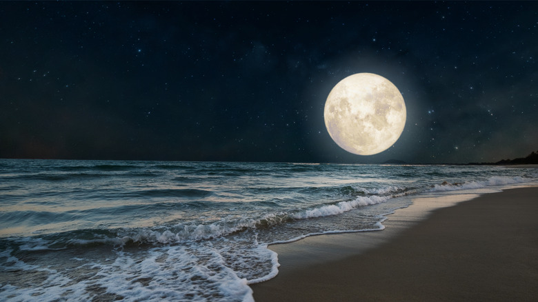 A full moon over the water.