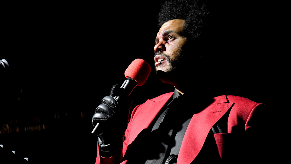 The Weeknd in red suit