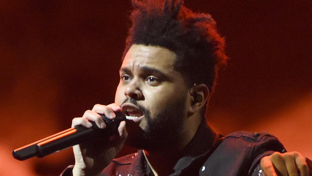 The Weeknd sings in concert