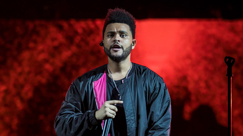 The Weeknd, performing on stage.