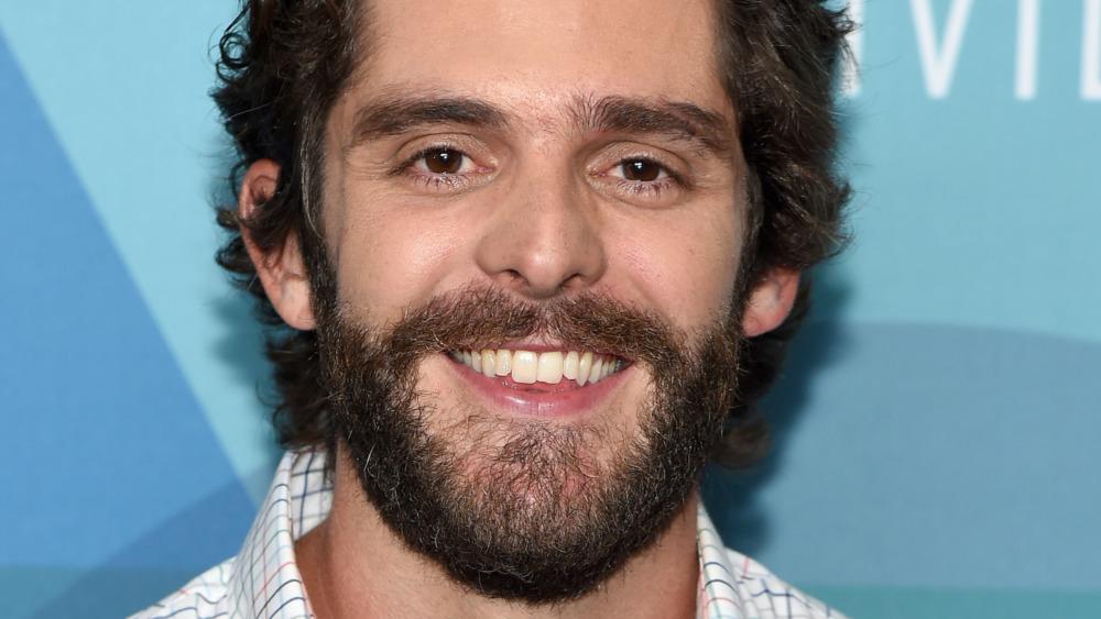 Thomas Rhett smiling
