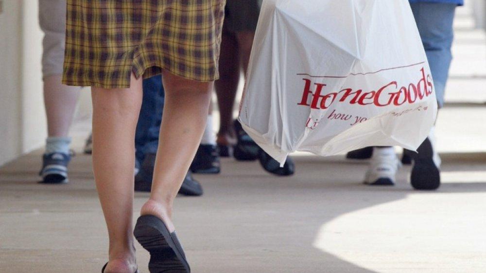 Woman carrying a HomeGoods bag