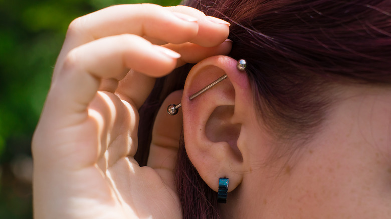 Woman with a cartilage and earlobe piercing
