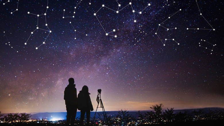 Couple looking up at constellations