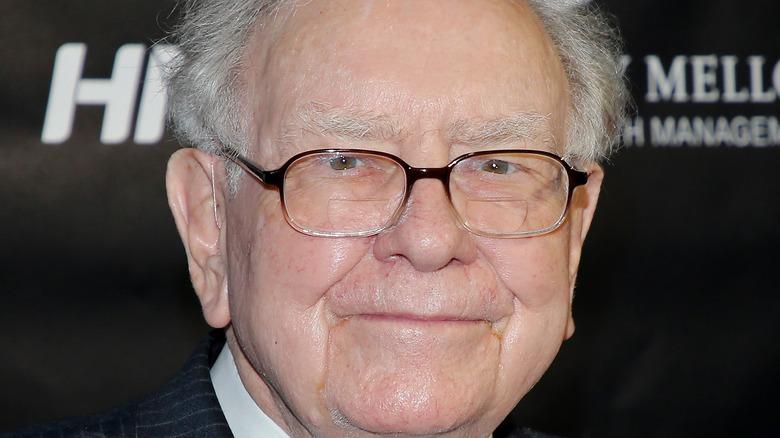 Philanthropist Warren Buffett grinning in glasses