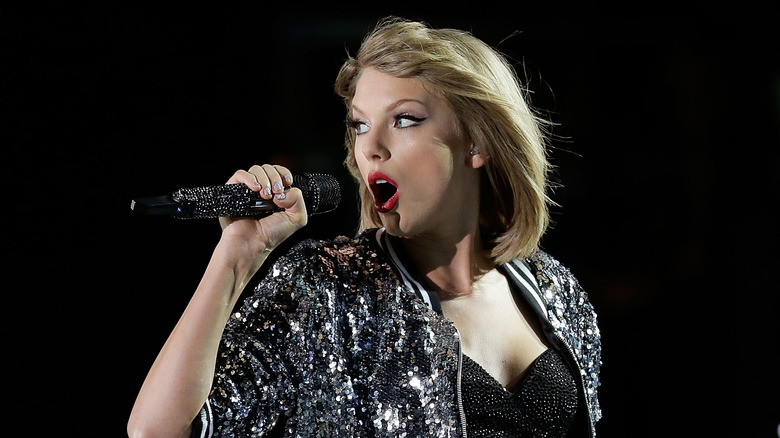 Taylor Swift singing into a microphone
