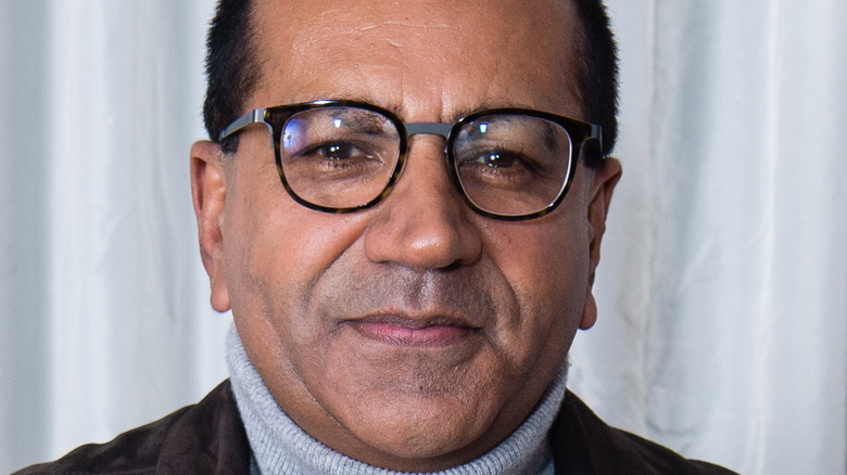 Journalist Martin Bashir in glasses and turtleneck