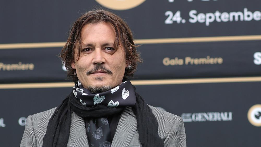 Johnny Depp wearing a heart scarf