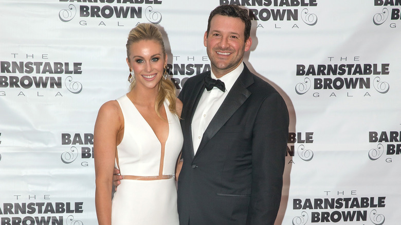 Tony Romo smiles with his wife Candice Crawford