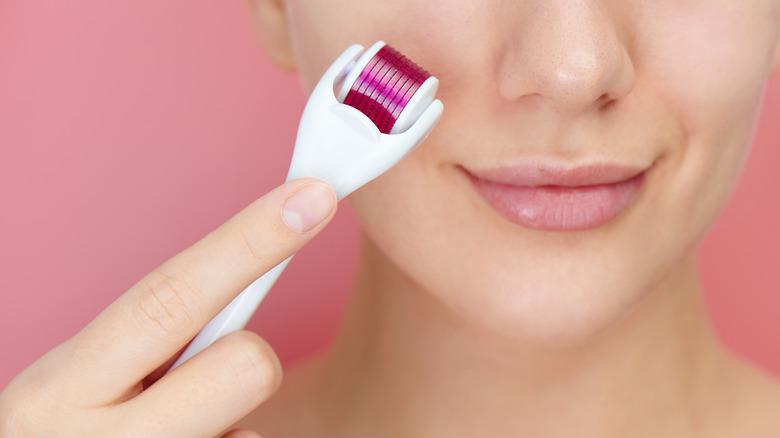 Woman microneedling face