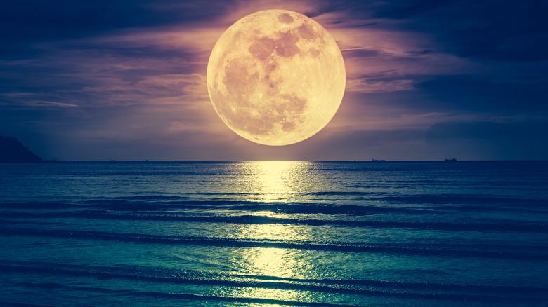 Full moon over the ocean.