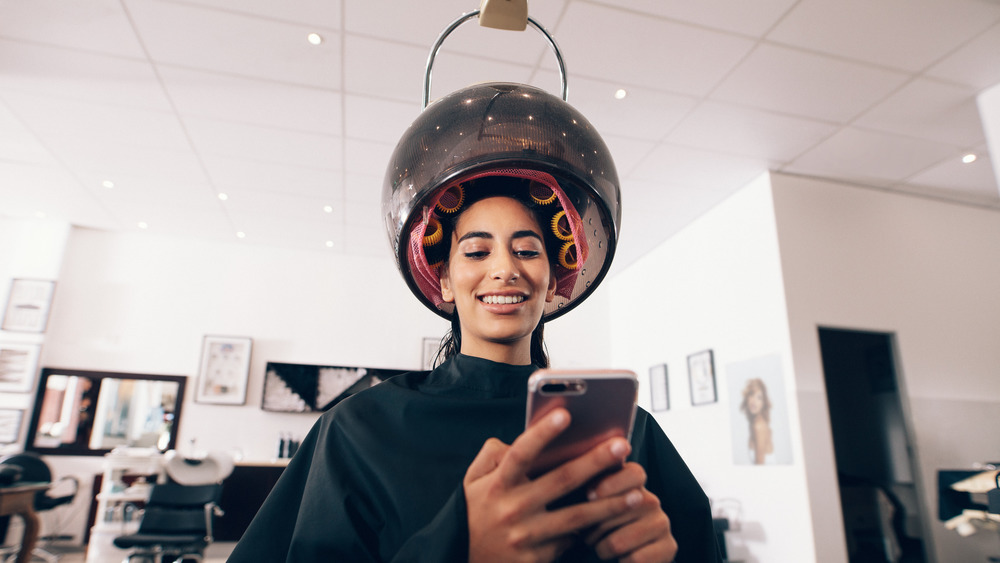 Girl sitting at a hair salon