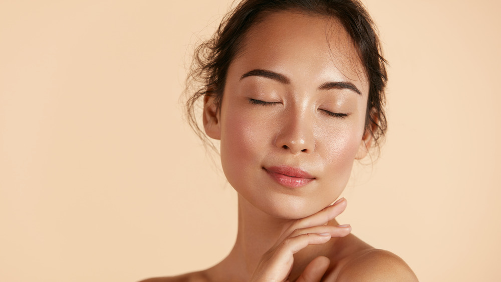 Fresh-faced woman with closed eyes