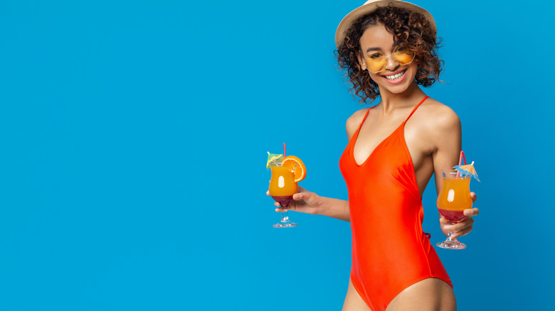 smiling young girl in a red swimsuit