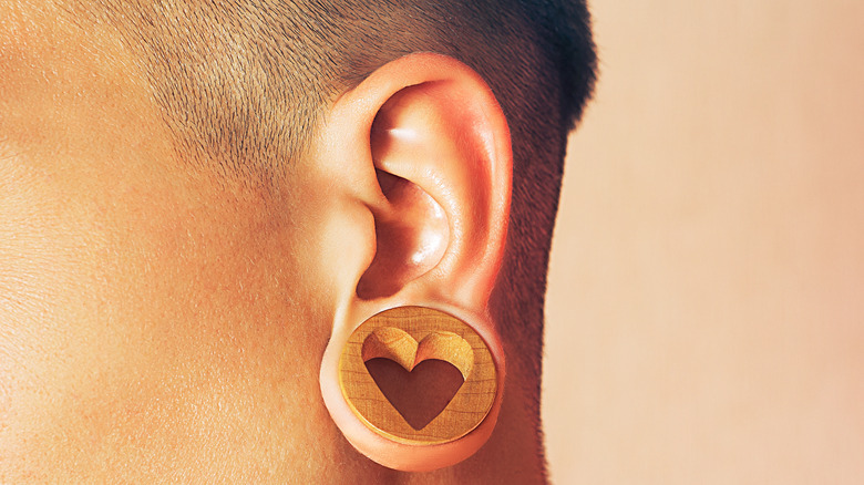 Person with ear gauges