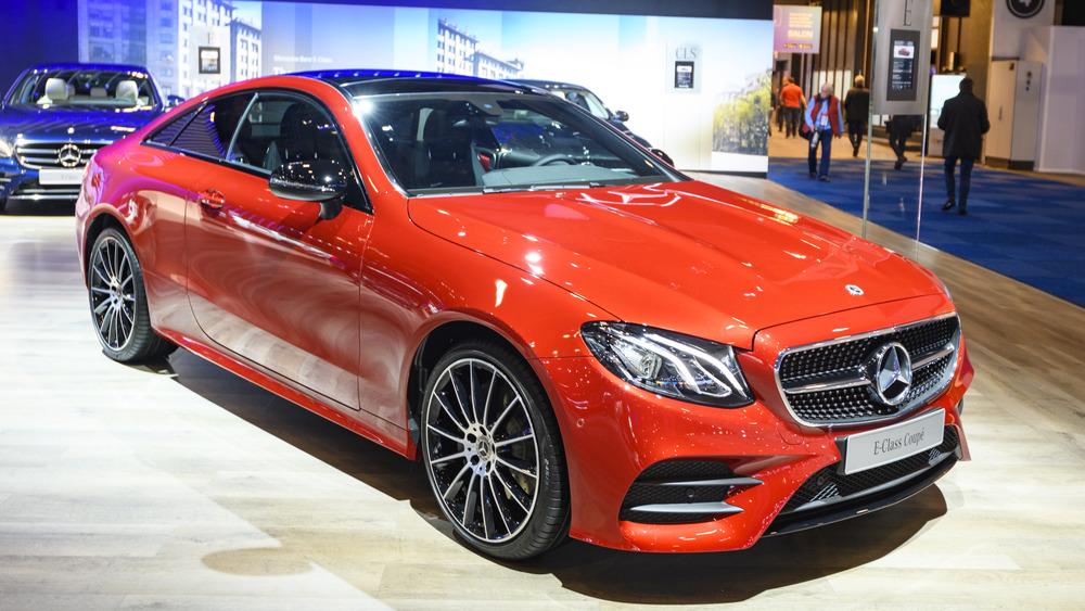 A red Mercedes-Benz E-class is seen at a car show.