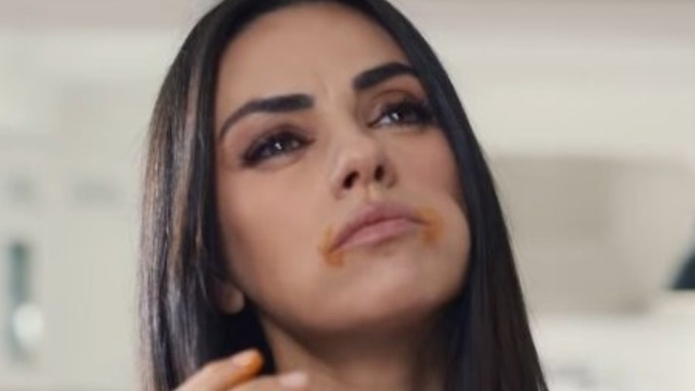 Mila Kunis eating Cheetos in commercial