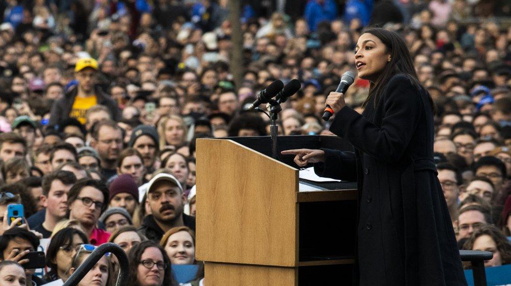 Alexandria Ocasio-Cortez speaking at a campaign rally