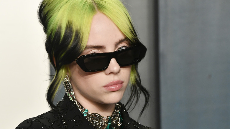 Billie Eilish with green roots