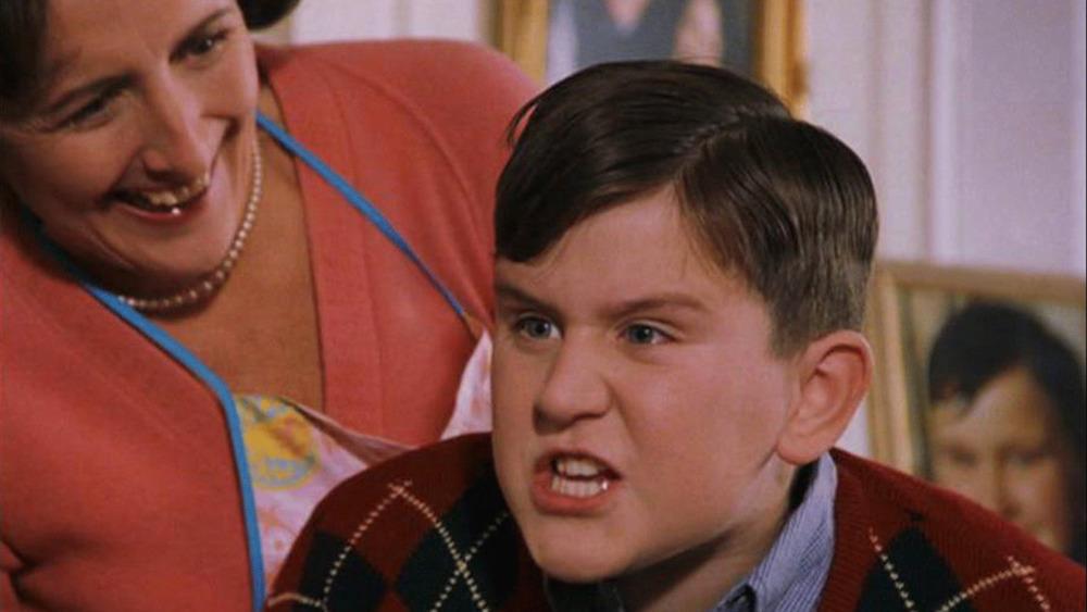 Harry Melling sneers as Dudley Dursley in Harry Potter