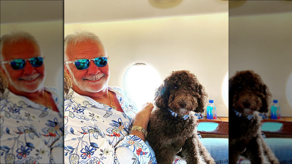 Below Deck's Captain Lee Rosbach smiling while petting his dog