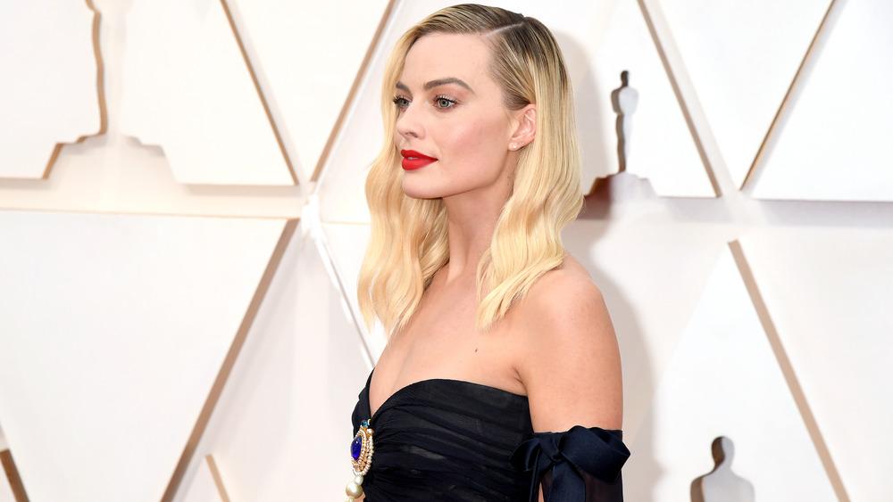 Margot Robbie raising one eyebrow