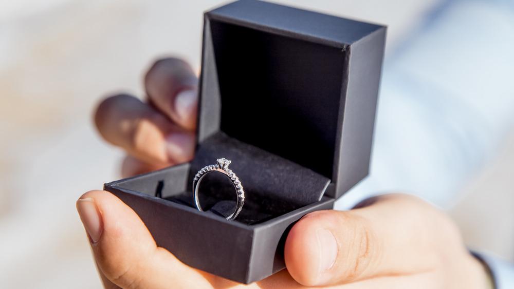 Man opening ring box