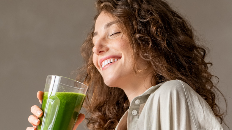 Woman drinking a green smoothie