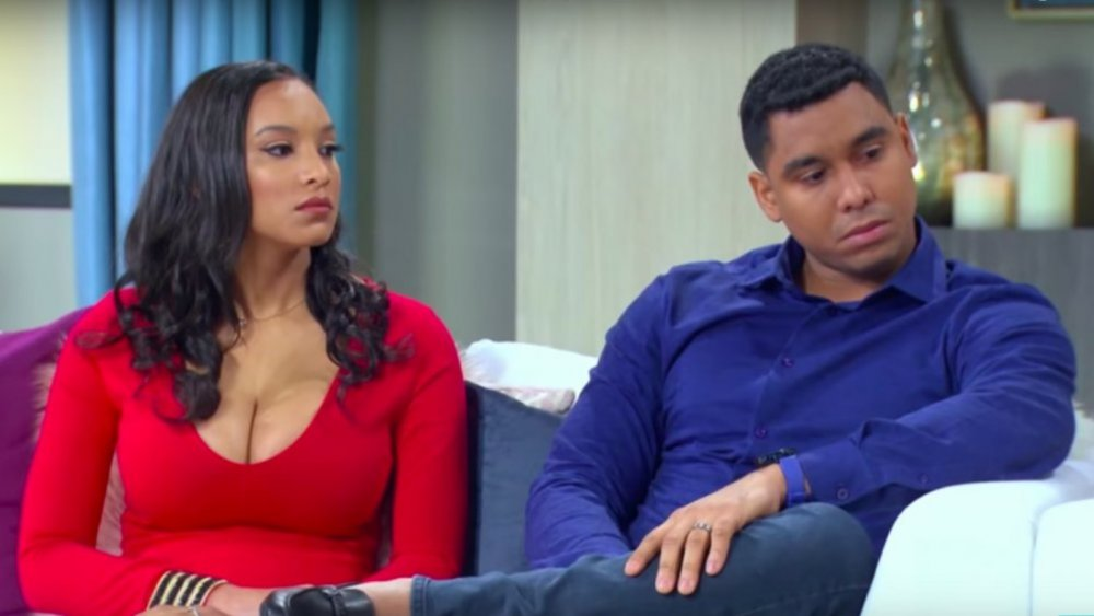 90 Day Fiance stars Chantel and Pedro sitting on a couch, looking serious