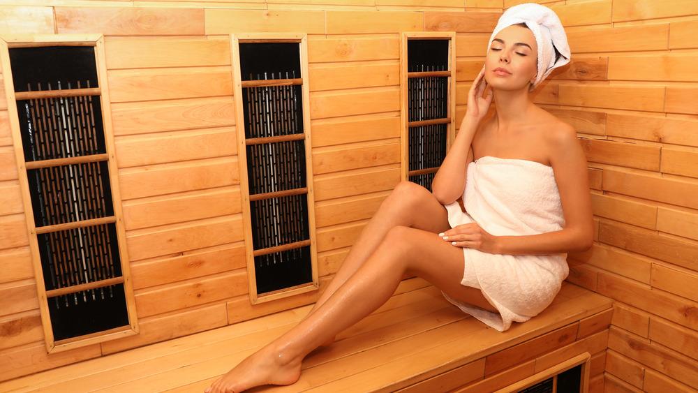 Woman sitting in a sauna