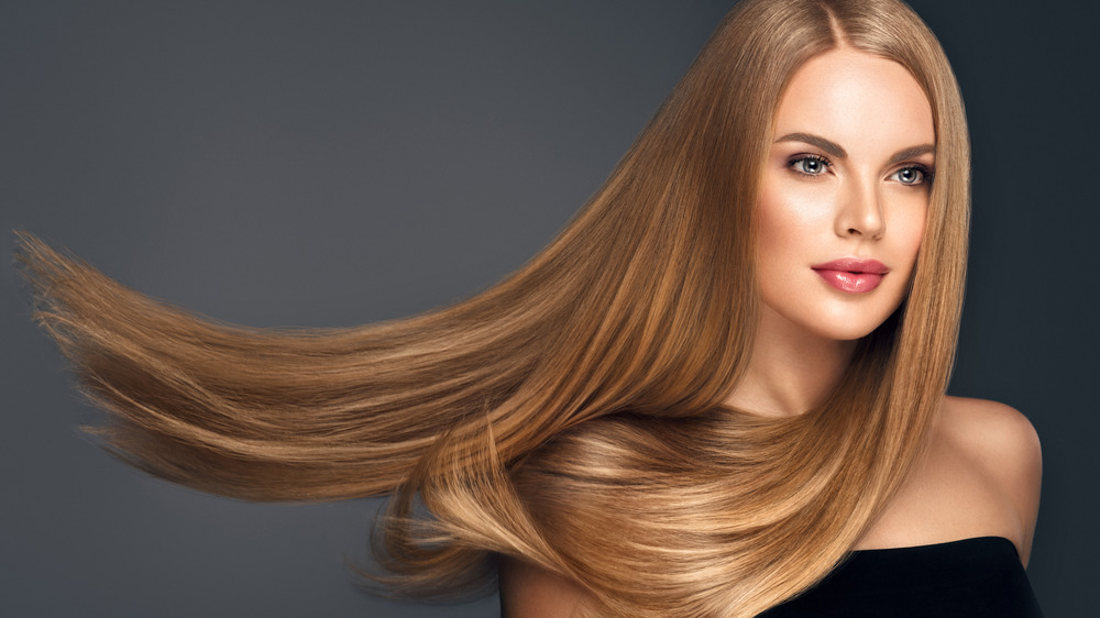 Woman with long hair flowing
