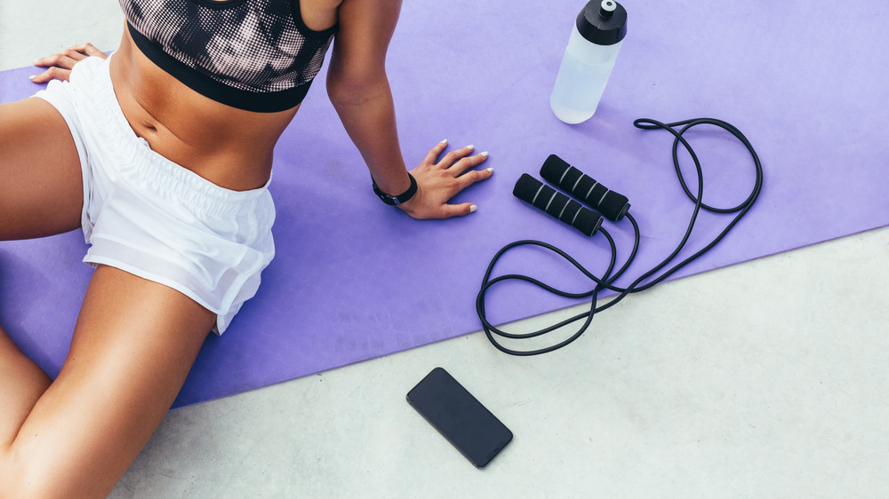 Woman working out, next to jump rope