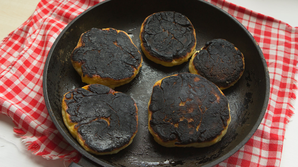 Burnt biscuits in a cast iron pan