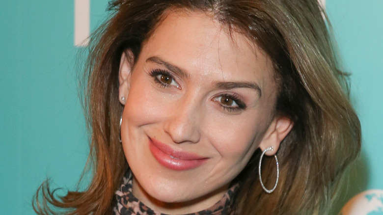 Hilaria Baldwin smiles with her hair down