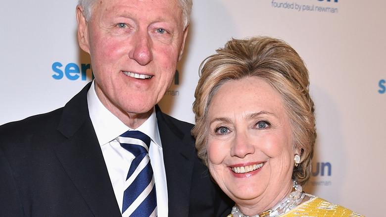 Hillary Clinton and Bill Clinton smile