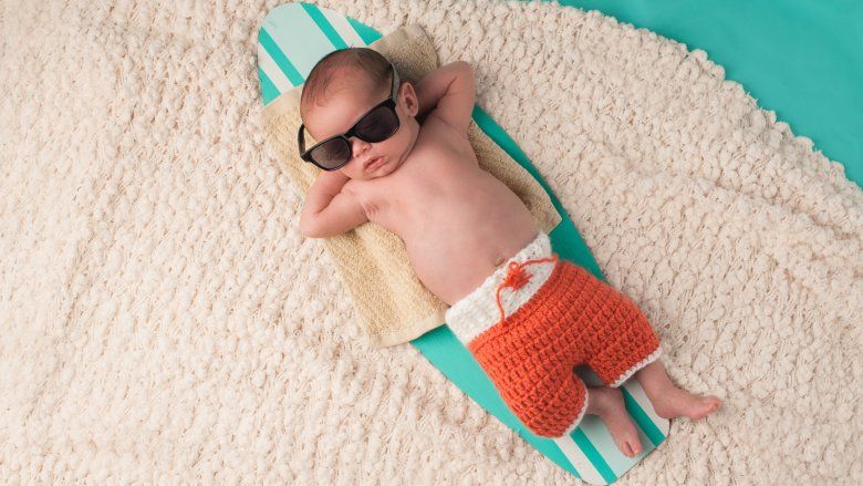 baby with sunglasses in beach scene