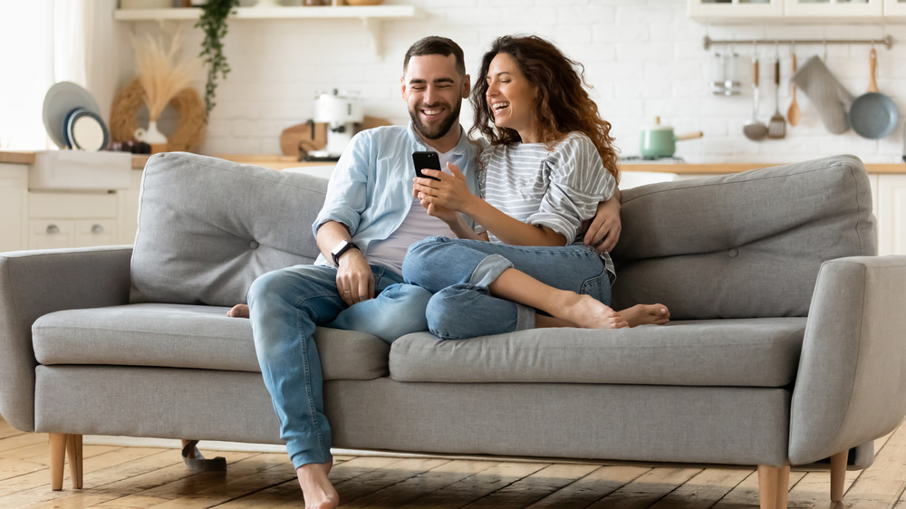 couple relaxing in cozy living room
