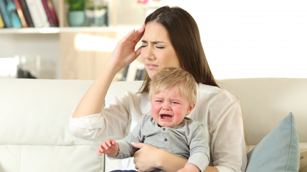 mom with baby crying