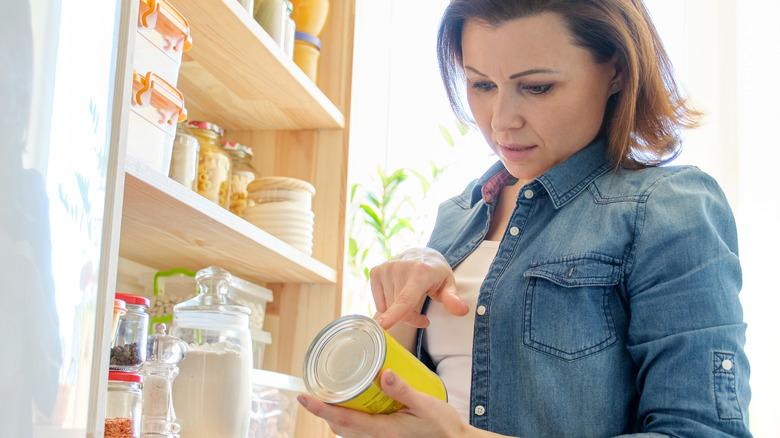 Woman organizing pantry shelves