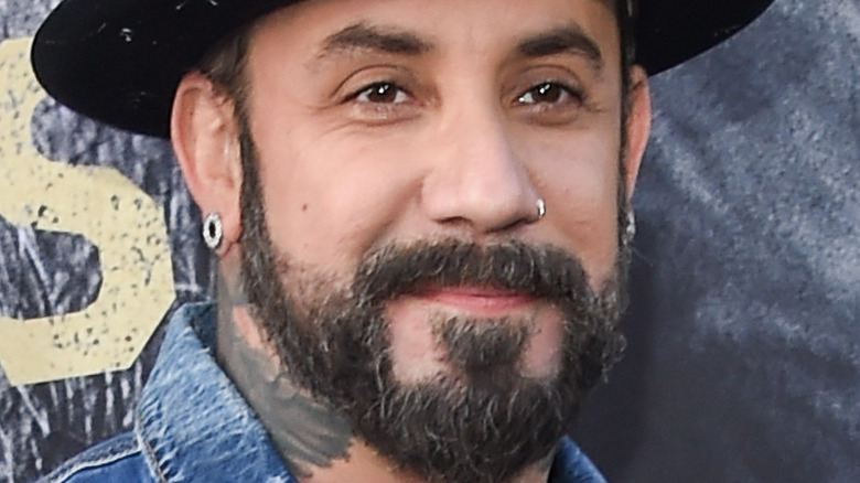 Aj McLean with slight smile and facial hair