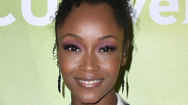 Yaya DaCosta poses on the red carpet