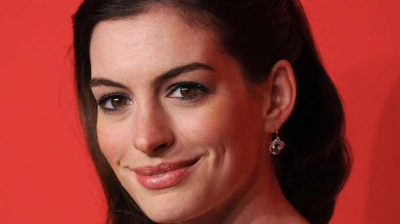 anne hathaway smiling closed mouth