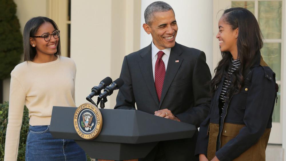 Sasha, Malia, and Barack Obama